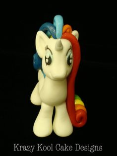 Top off your beautiful cake with this precious rainbow colored my little pony-like topper! Dont be surprised if she starts prancing and