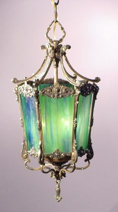 Blue Green Glass Lantern. (( clear glass can be altered, see DIY's on Pinterest for several ways to color glass ))