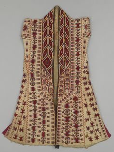 Coat ~ 'chyrpy' ~ Turkmenistan; Tekke Turkmen | Mid 19th to early 20th century | Cotton, silk, wool  || This is an example of a coat for an older woman. It was worn as an outdoor veiling garment, hanging from the head and covering the upper body. Its intricate silk embroidery in red and blue shows a tulip motif, the most typical floral pattern used to decorate women's traditional garments.