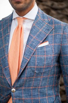 Shop this look on Lookastic: http://lookastic.com/men/looks/white-dress-shirt-orange-tie-white-pocket-square-blue-blazer/9400 — White Dress Shirt — Orange Wool Tie — White Pocket Square — Blue Check Wool Blazer