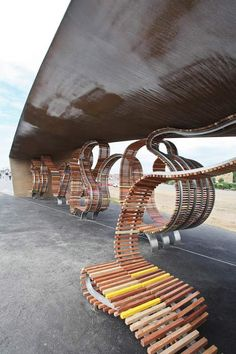 Providing seating for 300 people, this bench is made of reclaimed tropical hardwood, salvaged from landfill and old seaside groynes, with colourful stainless steel bars inserted wherever the form twists, bends or dips. The bench is already the longest in the UK and there are plans to extend it to 621 metres.