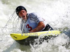 A breath of Fresh Air - Tyler Hinton takes a breath after going under water while competing in the Men's C1 during the U.S. Olympic Canoeing Trials for whitewater slalom in Charlotte, North Carolina.