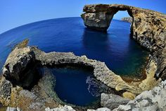 A natural arch in Malta called the Azure Window, which is shown here on May 20, 2014, collapsed in March 2017 after heavy storms hit the area. Credit: Sascha Steinbach/Getty Images (via Livescience)