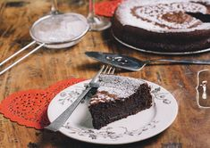 Valentines Day Flourless Chocolate Cake | A dessert that commands a tall glass of milk or a scoop of ice cream, now that's my ideal Valentine's Day dessert.  This Flourless Chocolate Cake perfectly satisfies those qualifications, being dense with rich, dark chocolate, and the perfect companion of milk or ice cream. | From: thevintagemixer.com