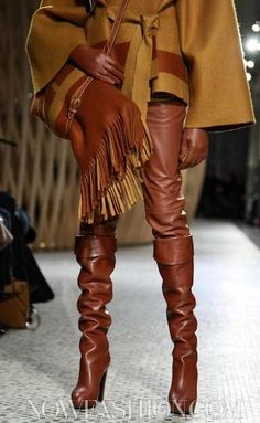 HERMES - Dark tan leather boots, trousers and wool poncho.