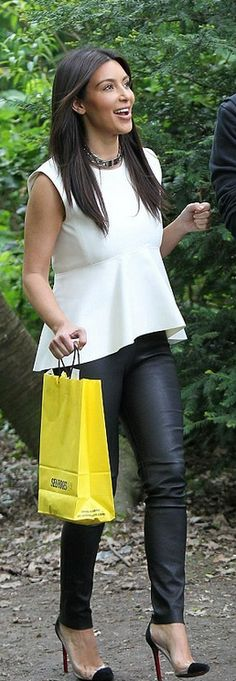 Not a Kardashian fan, but this outfit - peplum + skinny leather leggings + cap toe pumps = my dream right now