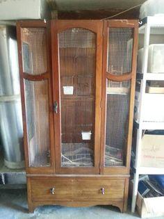 Armoir converted to bird cage