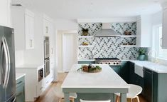 """Karen Berkemeyer Home on Instagram: """"Green and white cabinets paired with this stunning waterjet mosaic by @artistic_tile. ✨ Designed by Amy Bryant Eisenberg • @studio.bryant…"""" Artistic Tile, Kitchen Images, White Cabinets, Amy, Mosaic, Studio, Green, Table, Furniture"""
