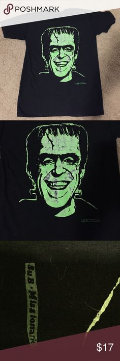 Herman Munster T-shirt Rad Herman Munster tee! Looks to be very vintage. Worn in. Doesn't come with a size tag, I would say it's a size small. Not sure of designer but there is what looks like a company name on the bottom right hand corner of the tee. The Munsters Tops Tees - Short Sleeve