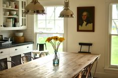 wood table + metal chairs + kitchen cabinet