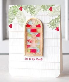 Stained Glass Joy Card by Betsy Veldman for Papertrey Ink (September 2013) Stained glass affect is done by heat embossing on clear cardstock then coloring with Copics then she turned it into a shaker window with glitter behind it.  So clever and cute!