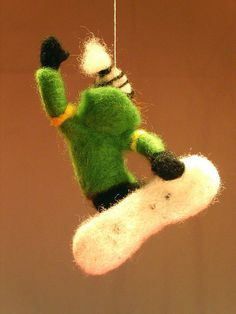 Needlefelted snowboarder nr 3 making Japan air    This cool snowboarder making a grab trick called Japan air (I think) is needlefelted of wool over an armature of pipecleaner.