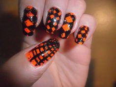 Third October 2012 Halloween nails design.  Spider web and diamond pattern designs!
