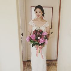 Bridal bouquet with pink peonies, tulips, roses, celosias, and eucalyptus