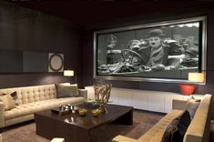 Gentlemen's Lounge - the best home theatre I've seen yet.  Who says you have to use those overgrown leather chairs with the built-in drink holders? Love the frame around the screen.