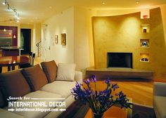 Stylish built in shelves and TV wall of plasterboard with lighting ideas