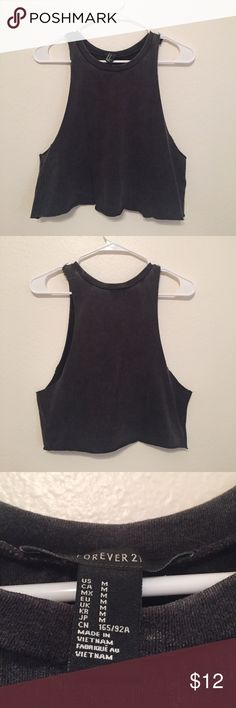 Black muscle cropped tank top A black muscle cropped tank top in a size M from forever 21. The top is more of a small than a medium. Has only been worn once! Forever 21 Tops Tank Tops