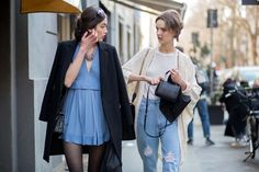 Blue dress, black tights, black coat draped over shoulders; White simple halter tank, oversized cardigan, high-waisted ripped jeans // MFW street style