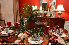 Christmas Table Setting Tablescape with Plaid Plates and a Natural Greenery Centerpiece