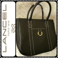 Lancel Paris Leather Handbag Lancel Paris Designer Leather Purse, Rare Collector's Piece in Elegant Black with Gold Metal Hardware, Zipper Top Closure.  Approx Size 11 in x 9 in x 2.5 inches, Another Rare Find in my Luxe Purse Collection,  Overall Mint Condition, a Great Closet Add! Lancel  Bags