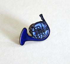 "-1.25"" soft enamel lapel pin inspired by a reference in a popular TV show -it is blue, but looks a bit dark because of the small size and the black enamel metal used -single post back -back reads The Silver Spider Buy more, save more here: https://www.etsy.com/listing/272332958/ ..."