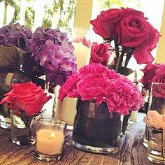 mixed centerpiece with hot pink carnations, fuchsia and hot pink roses, purple hydrangea, and pink peony.