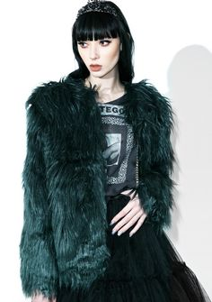 Madison Faux Fur Coat will have ya sittin' pretty on 5th avenue, bb~ This luxxxurious coat features a plush dark green faux fur construction, boxy fit, and a shaggy, cozy style to top off yer high-society fit.