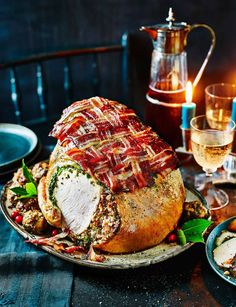 With its bacon lattice topping, this juicy roast turkey crown makes an impressive Christmas dinner centrepiece.