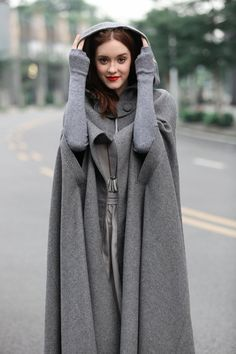 maxi wool cape in winter.fully lined.a zipper button on the fasteningflattering dress bottom strong sense of presence[Standard US/UK/FR/GR sizes]Cashmere Wool Hooded Cloak - Black, Red, or Gray Maxi CapeRetro Batwing-sleeves Cape Tops Long style The Wool Cape, Wool Poncho, Winter Cloak, Winter Cape, Winter Poncho, Winter Wear, Moda Outfits, Hooded Cloak, Maxi Coat