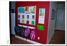 love this organization wall.... kids chore lists, homework, backpacks