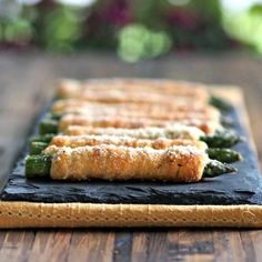 Crescent-Wrapped Asparagus with Boursin. Asparagus wrapped with crescent rolls spread with Boursin cheese then baked.Healthy, easy side, appetizer or snack.