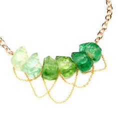 Emerald Green Resin Stone Necklace. Feminine and elegant, this Erika Lauren Design necklace exudes fairy-tale romanticism. It is made of plated gold and lightweight ombre emerald resin nuggets. $115