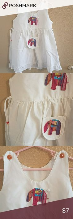 Handmade NWOT Girls Dress Size 4 Handmade From Thailand Size 4 NWOT Never worn but doesn't have any tags to include size/material tag. 2 Elephants on front one is a pouch. Sides can be tied and have beads attached. 2 buttons at Shoulders Dresses
