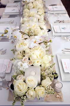 Table runner of fresh white flowers for a pure white wedding #purewhite #wedding