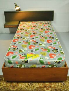 SINGLE DIVAN BED WITH ATTACHED HEADBOARD & SIDE TABLE/DRAWER.