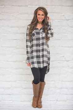 This beautiful black, grey, and white plaid tunic is perfect for all of your favorite fall adventures!