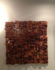 """Wall  sculpture by Chad Shell with assembly assistance from Ed Moon & John Selden.  Not only a very unique piece but also quite effective in reducing problems with echo & other issues related to sound reflections that can ultimately lead to very noisy spaces.  Media: fire-torched wood; epoxy  Size: 48"""" x 48""""   Production:  one of a kind; but similar concept can be commissioned through Chad Shell."""