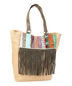 Say hello to haute-hippie accents! Decked out in a suede fringe trim and featuring cotton canvas fabric, this tote secures an effortless look with a bold boho statement, while moderate size offers ample storage for everyday essentials.