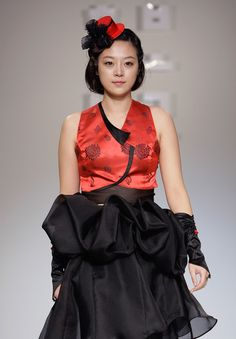 """A Model walks down the catwalk during the South Korean Traditional Costume 'HanBok' fashion show on October 21, 2011 in Seoul, South Korea. Hanbok is the traditional Korean dress. It is often characterized by vibrant colors and simple lines without pockets. Although the term literally means """"Korean clothing"""", hanbok today often refers specifically to hanbok of Joseon Dynasty and is worn as semi-formal or formal wear during traditional festivals and celebrations."""
