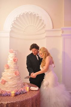 Radiant Orchid Inspired Wedding | The MIAMI Rose | Cutting the cake together at the wedding reception, a classic tradition | www.themiamirose.com
