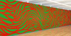 This wall drawing was created by Sol LeWitt. I chose this drawing because I like how he used complementary colors with a green background and red curved lines. I also like this drawing because it's an overall fun picture with the red lines curving and overlapping in different directions.