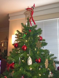 Elf on the Shelf cleans up the tree and waits for Santa