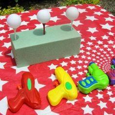 Carnival / Circus Themed Birthday Party The goal is to knock down the ping pong balls off of the tees with the squirt gun.The goal is to knock down the ping pong balls off of the tees with the squirt gun. Carnival Themed Party, Carnival Birthday Parties, Carnival Themes, Party Themes, Party Ideas, Carnival Theme Activities, Circus Party Games, Carnival Diy, Block Party Games