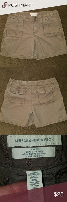 """Brown Abercrombie & Fitch shorts Light brown A&F shorts size large. These are very soft and comfortable! Laying flat 17.5"""" across with 5.5"""" inseam. You can roll them up and button them to make them shorter, it has a very cute moose logo on the cloth strap that holds it. No holes or stains. Abercrombie & Fitch Shorts"""