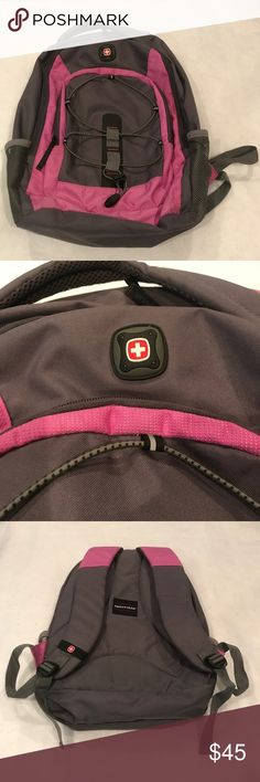 """Swiss Gear Gray / Pink Backpack with Laptop Holder In great shape & has only been very gently used a few times. It has two main compartments. The spacious main compartment has a padded computer/laptop pocket that will fit most laptops up to 16"""". Smaller compartment has a pouch for cell phone and holders for pens/pencils. Adjustable shoulder straps with padding and air-mesh backside as well as padded top handle. Two side exterior pockets for water bottles.  Dimensions: 18.5"""" H x 13.5"""" L x 7""""…"""
