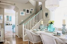 DIY Home Details; like a custom painted handrail on the stairway, and coastal chic created dining table make this space special  by Breezy Design at foxhollowcottage.com
