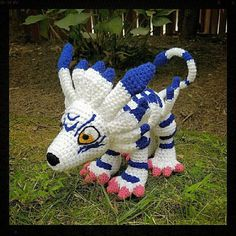 Digimon Inspired: Garurumon Amigurumi Crocheted Plushie/Plush  Handmade plushie (in crochet Amigurumi style) of one of the most beloved original Digimon, Garurumon!  Garurumon measures 11in long from nose to rump (with an 7in long tail that has wiring inside allowing it to be fully pose-able), 8in tall and 6in wide. He features his iconic detailing from the original anime - all of his details are crocheted on, except for his eyes, nose and facial markings which are needle-felted on…