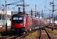 ÖBB a Railjet train departs towards Wien pushed by the electric locomotive 1116 223 at Linz Hbf Corporate Identity Design, Electric Locomotive, Steam Locomotive, Europe Train, Rail Train, Rail Transport, S Bahn, Speed Training, Vienna Austria