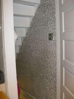 Harry Potter written on the wall of the cupboard under the stairs