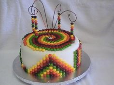 Skittles Cake, thinking maybe making a skittles chandalear to go on the cake?